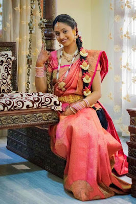 This pink and orange color South Indian wedding saree is delicate and feminine.