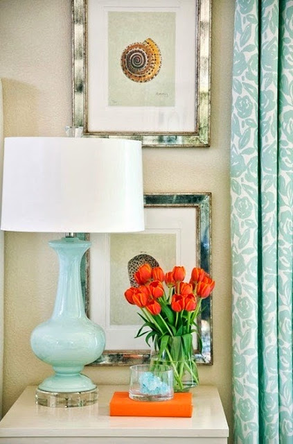 still life with orange details and turquoise lamp, curtain