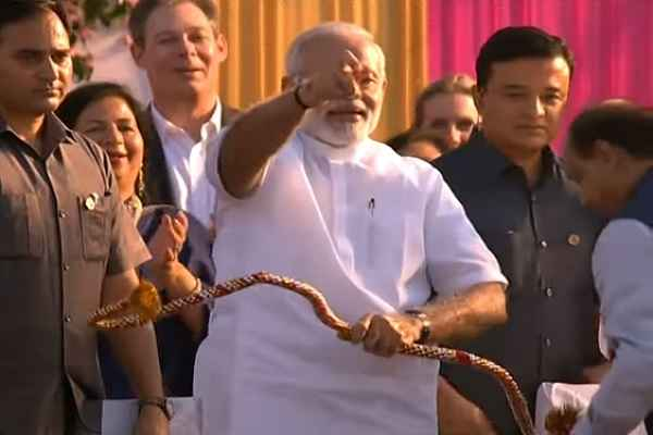 pm-narendra-modi-thrown-teer-with-hand