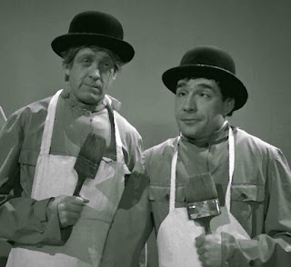 Vianello (left) with Ugo Tognazzi in a sketch from their 1950s satirical TV show Un due tre