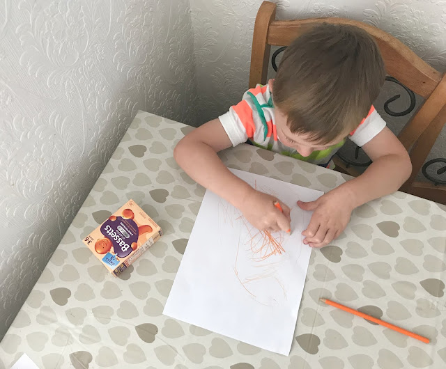 Jacob drawing a orange picture of what his vitamins taste like
