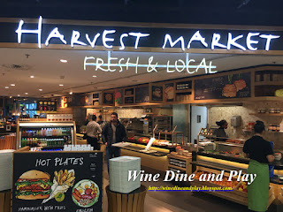 "The entrance to Harvest Market at concourse ""D"" in Amsterdam Airport"