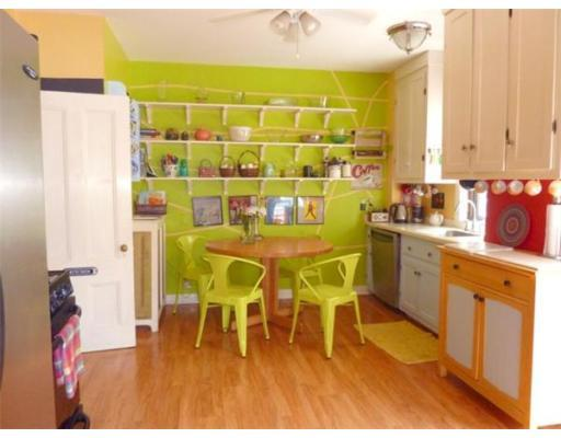 Red, yellow, orange, and white kitchen... with acid green accent wall ...