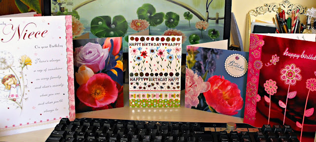 my desk full of birthday cards