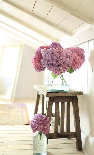 hydrangeas in blue glass bottles
