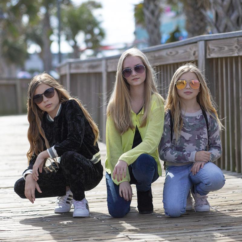 tween girls showing off Graffiti Gloss clothing
