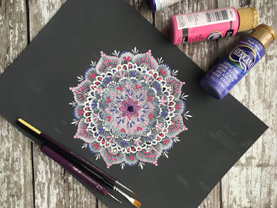 A beautiful handpainted mandala created using delicate lace folk art techniques and comma strokes, all taught in the painting kits from www.folkit.co