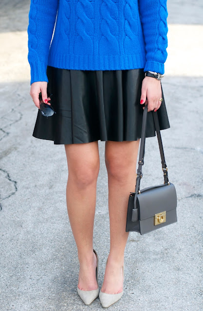 black leather skirt paired with cobalt blue cashmere and ferragamo bag