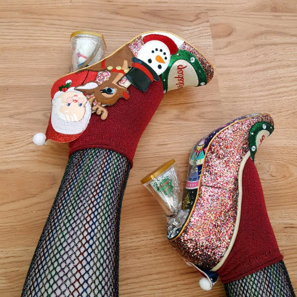 wearing glitter shoes with festive theme, rainbow fishnet tights and sparkly socks