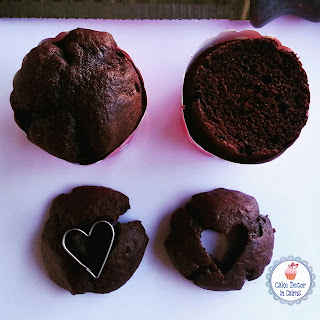 Cutting chocolate cupcakes and cutting out heart shapes.