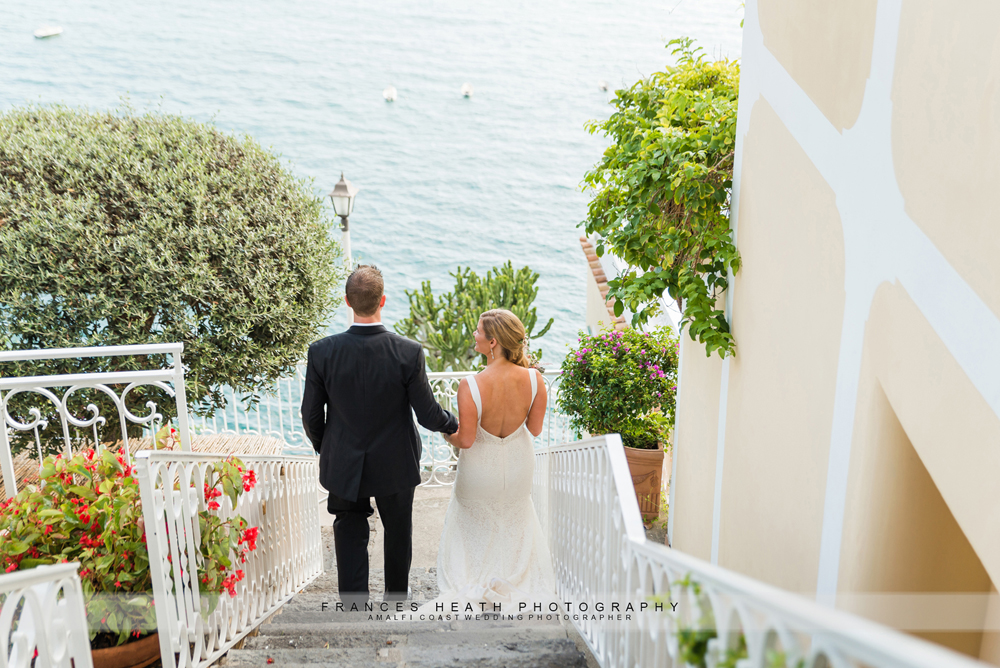 Bride and groom walking in Positano