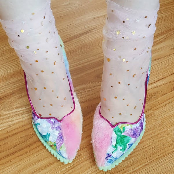 close up of pointed toe court shoes with split design in rainbow fur and pegasus print