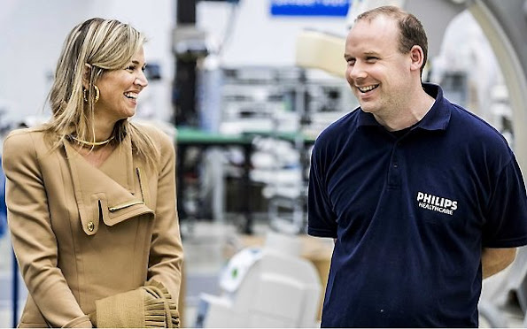 Employees of Philips' Innovation and Production Centre in Best take pictures of Netherlands' Queen Maxima during a visit