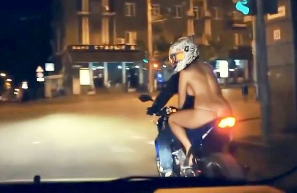 Woman Rides Motorbike Wearing Nothing But A Skimpy Thong Pics-8015