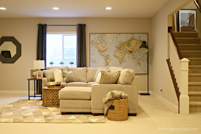 Basement family room set up with floating sectional
