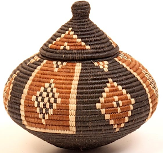 Ukhamba African Zulu baskets are decorative and colorful bulb shaped container, made watertight by the tautness of the weave.