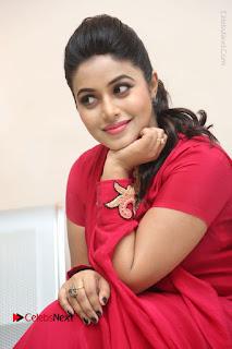 Actress Poorna Latest Stills in Red Dress at Rakshasi First Look Launch  0264.JPG