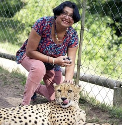 lady petting a cheetah that then ate her