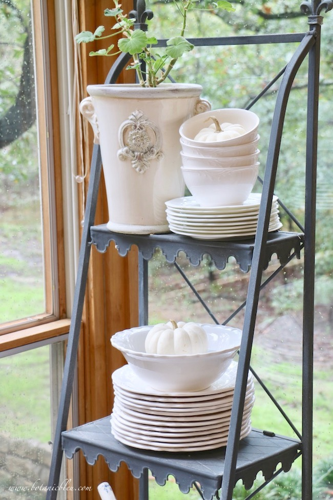 Easy inexpensive fall decor on a french style plate stand with pumpkins in white dishes