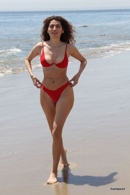 Blanca Blanco Playing With Ocean Waves At The Beach