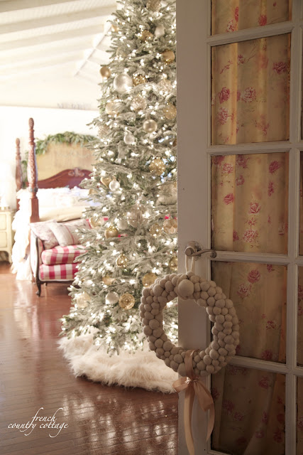 Wreath on door and Christmas tree in bedroom