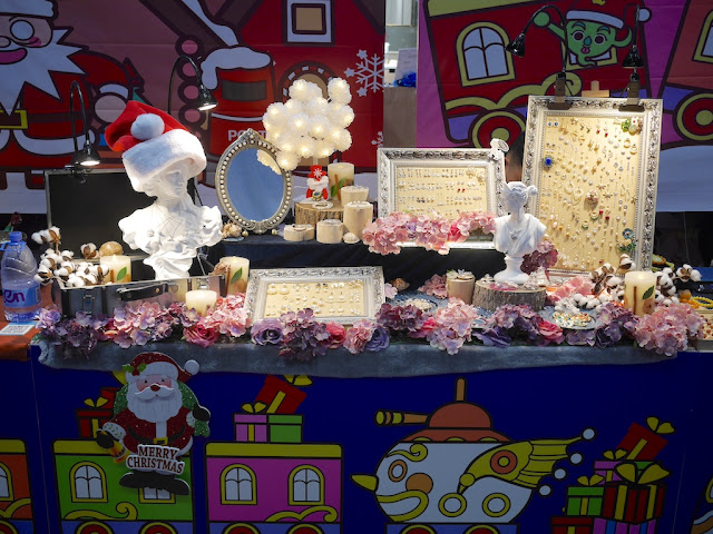 vendor stall with Santa-themed decorations