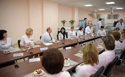 Vladimir Putin in the new perinatal centre at Bryansk.