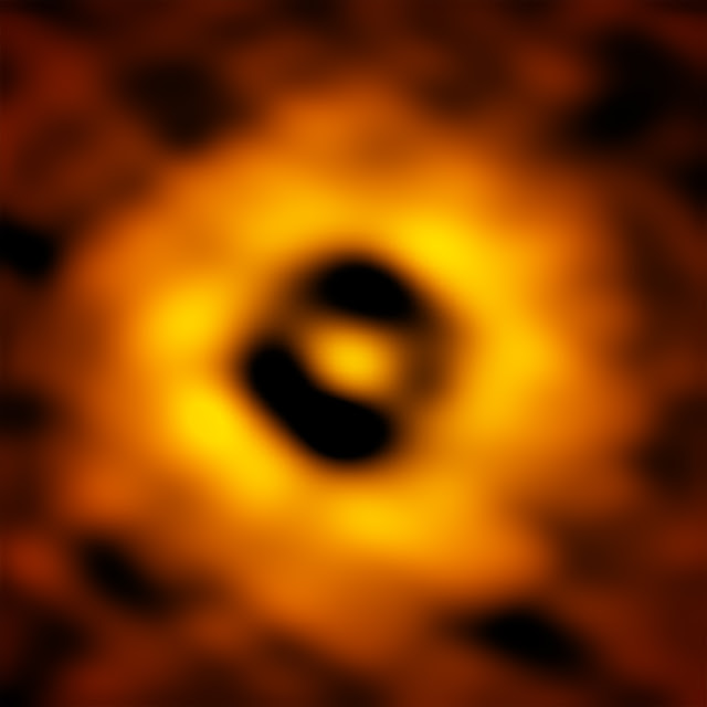 The inner region of the TW Hydrae protoplanetary disk as imaged by ALMA. The image has a resolution of 1 AU (Astronomical Unit, the distance from the Earth to the Sun in our own Solar System). This new ALMA image reveals a gap in the disk at 1 AU, suggesting that a planet with the same orbit as Earth is forming there. Credit. S. Andrews (Harvard-Smithsonian CfA); B. Saxton (NRAO/AUI/NSF); ALMA (ESO/NAOJ/NRAO)