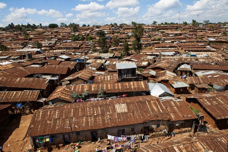 Kibera, The Nairobi neighborhood of Kibera, Africa's largest urban slum, in which around 1 million people live in close-packed tin shacks.