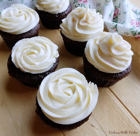 chocolate cupcakes with sweetened condensed milk buttercream piped in rosettes and ruffles
