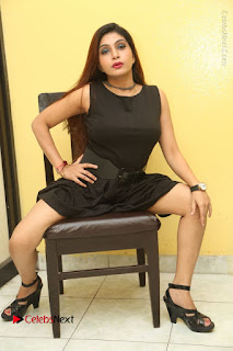Tollywood Upcoming Actress Pooja Roshan Stills in Black Short Dress at Plus 1 Movie Trailer Launch  0306.JPG