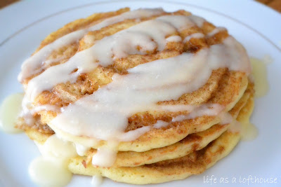 Cinnamon Roll Pancakes have swirls of cinnamon through out and are topped with a delicious cream cheese glaze. Life-in-the-Lofthouse.com