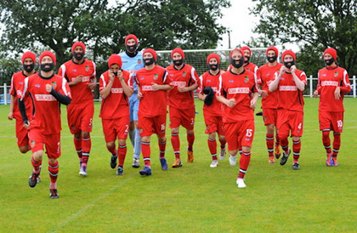 Kendal Town players is seen training wearing fake beards as part of a sponsorship deal