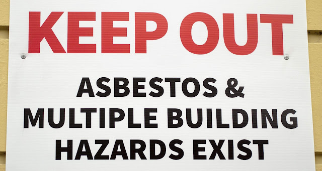 "Christchurch earthquake before and after: Sign reading ""Keep Out: Asbestos, Mulitple Building Hazards Exist"""