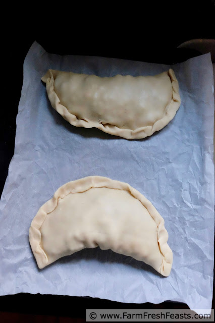 pie crust crimped around sausage and vegetable filling