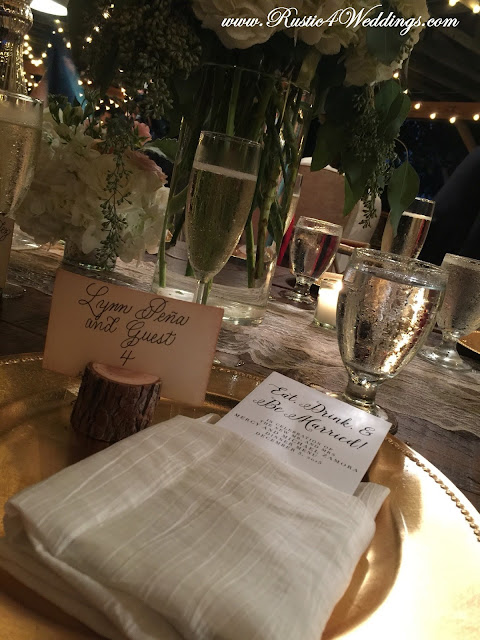 Place Setting at Rustic Beach Wedding Featuring a Rustic Tree Branch Place Card Holder