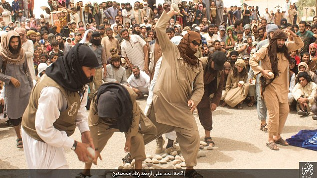 OMG! See How ISIS Militants Savagely Stone 4 Married Men To Death For 'Committing Adultery' - PHOTOS!