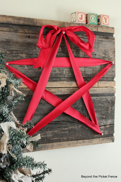 Barnwood Ribbon Star Wall Hanging | 50 Awesome DIY Yule Decorations and Craft Ideas You Can Make for the Winter Solstice