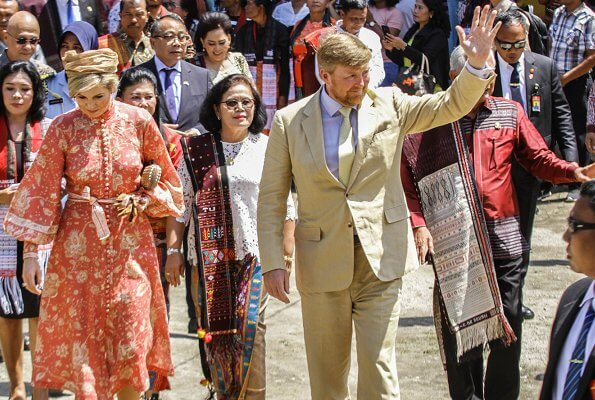 Queen Maxima wore Zimmermann Veneto border paisley print linen dress. Maxima visited a traditional Batak village and Del Institute