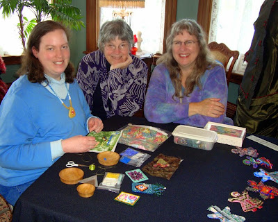 Pre-opening demonstration of bead embroidery process by Robin Atkins, with Becki Applegate and Christy Hinkle