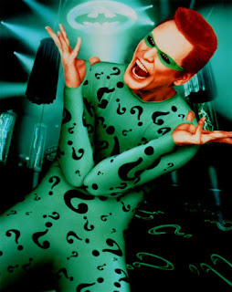 Jim Carrey como Charada no filme Batman Eternamente