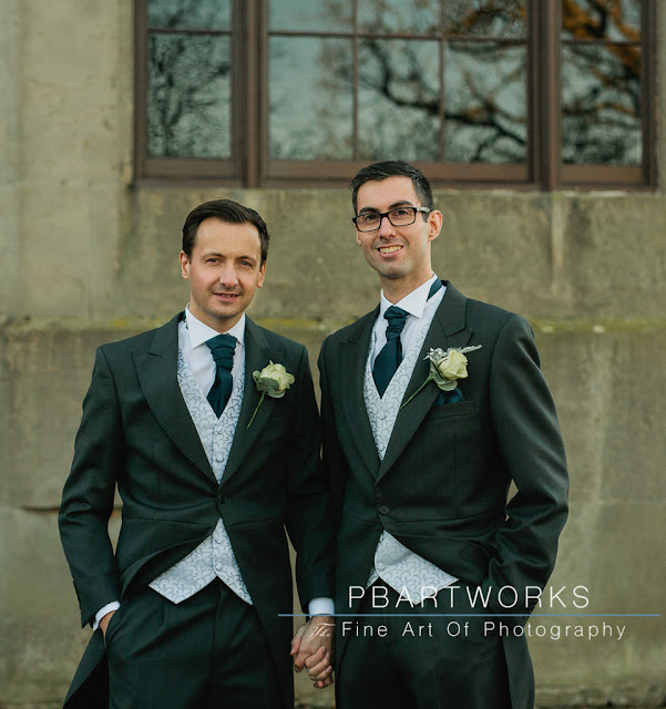 Groom and Best Man Holding Hands