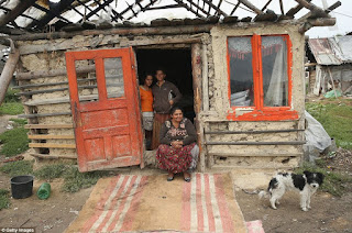 http://www.dailymail.co.uk/news/article-2424296/At-home-Roma-Remote-villages-people-struggle-terrible-poverty-continue-traditional-way-life.html