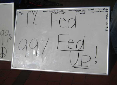 Whiteboard with message 1% fed, 99% fed up
