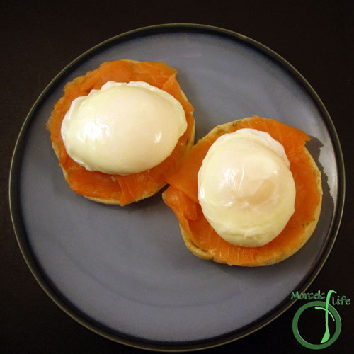Morsels of Life - Smoked Salmon Benedict Step 3 - Place smoked salmon on half an English muffin, and then top with poached egg. Top with Hollandaise sauce.