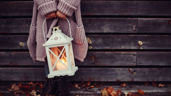 Autumn Leaves and a Child with a Lantern