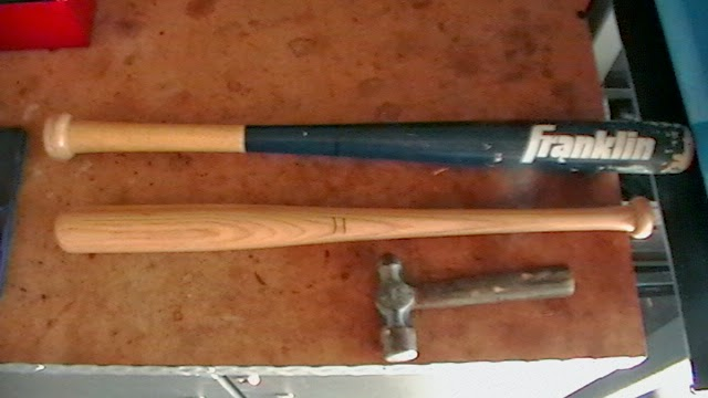 Two small baseball bats and the hammer.