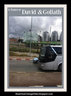 David and Goliath - Trip to Valley of Elah | Photo of a tour bus and buildings