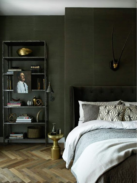 Gorgeous dark green walls in bedroom with herringbone floor on Hello Lovely
