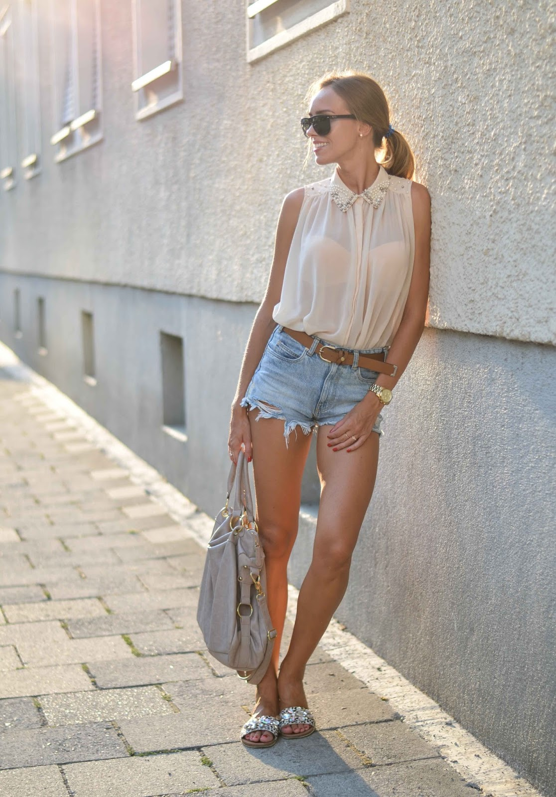 kristjaana mere denim shorts sleeveless sheer top summer outfit